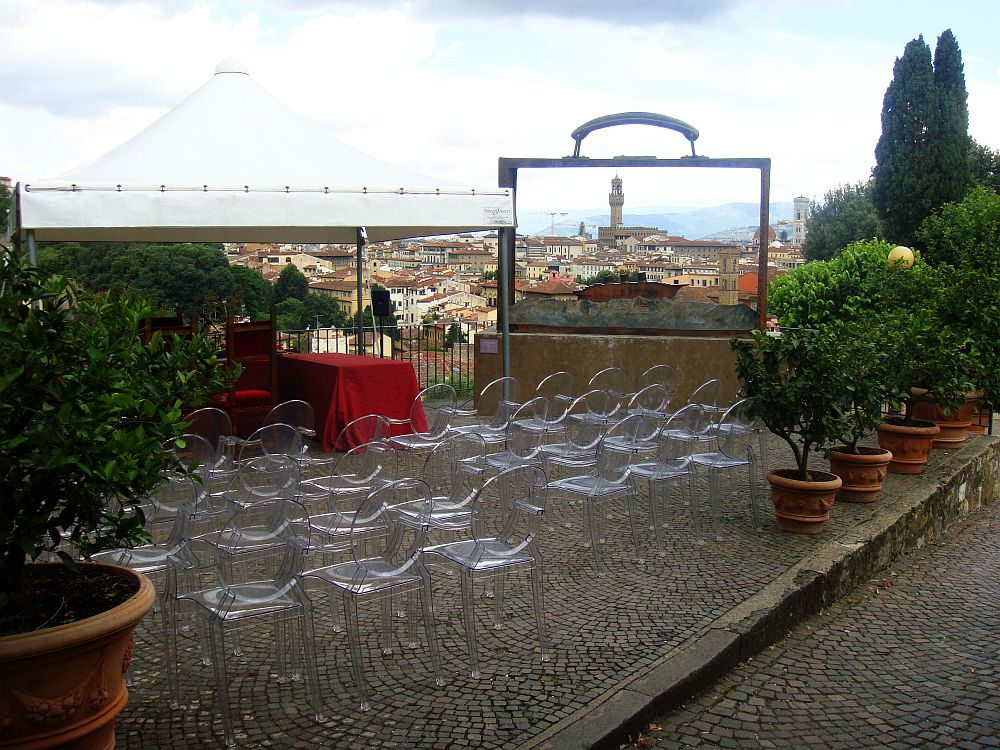 Designer set-up with panorama over Firenze made with iconic Louis and Victoria Ghost chair signed by Philippe Starck for Kartell