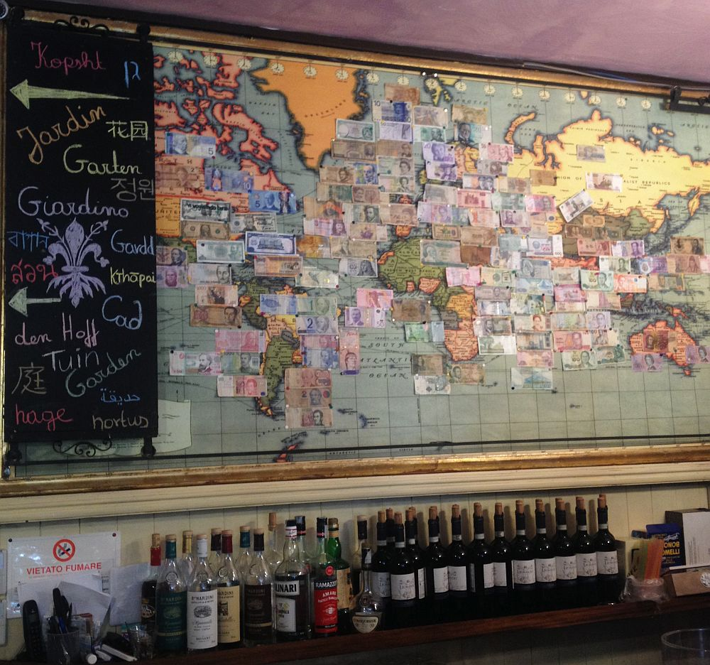 Trattoria Boboli's worls map is filled with banknotes of the respective countries, including Romanian lei