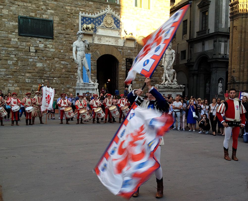 Amazing ability demonstration made by citizens of Firenze with medieval flags on alert rhythm of drums